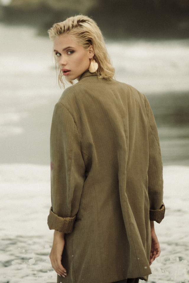 Beautiful Russian fashion model Elizabeth wearing an oversized suit jacket. Photographed ny Russian photographer Amir Agaev.