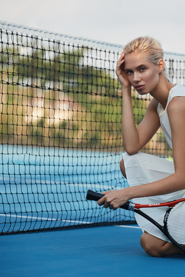 Fitness shoot photographed at Tennis Liga in Bali. Elizabeth is courtside in tennis attire. Photographed by sports photographer Jay Shepherd