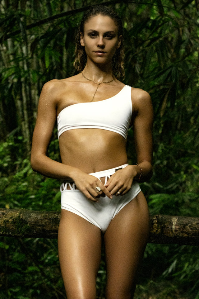 Model Simi Kowalski on location doing a swimsuit shoot